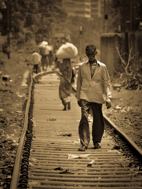 A man walks along the railway tracks near Mallick Ghat, Calcutta.