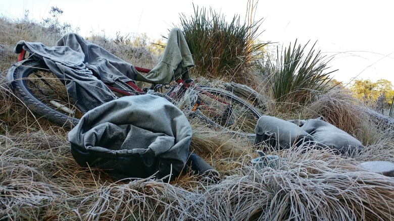 Bicycle and gear covered in hard frost in the morning.