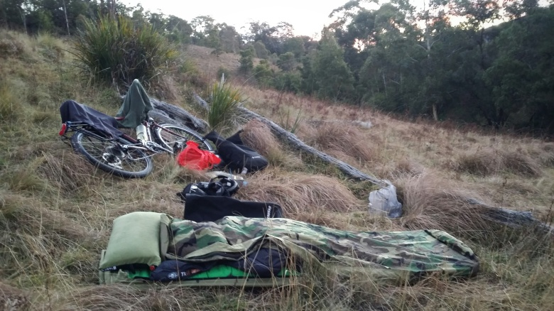 Bivy setup at twilight on the hillside.